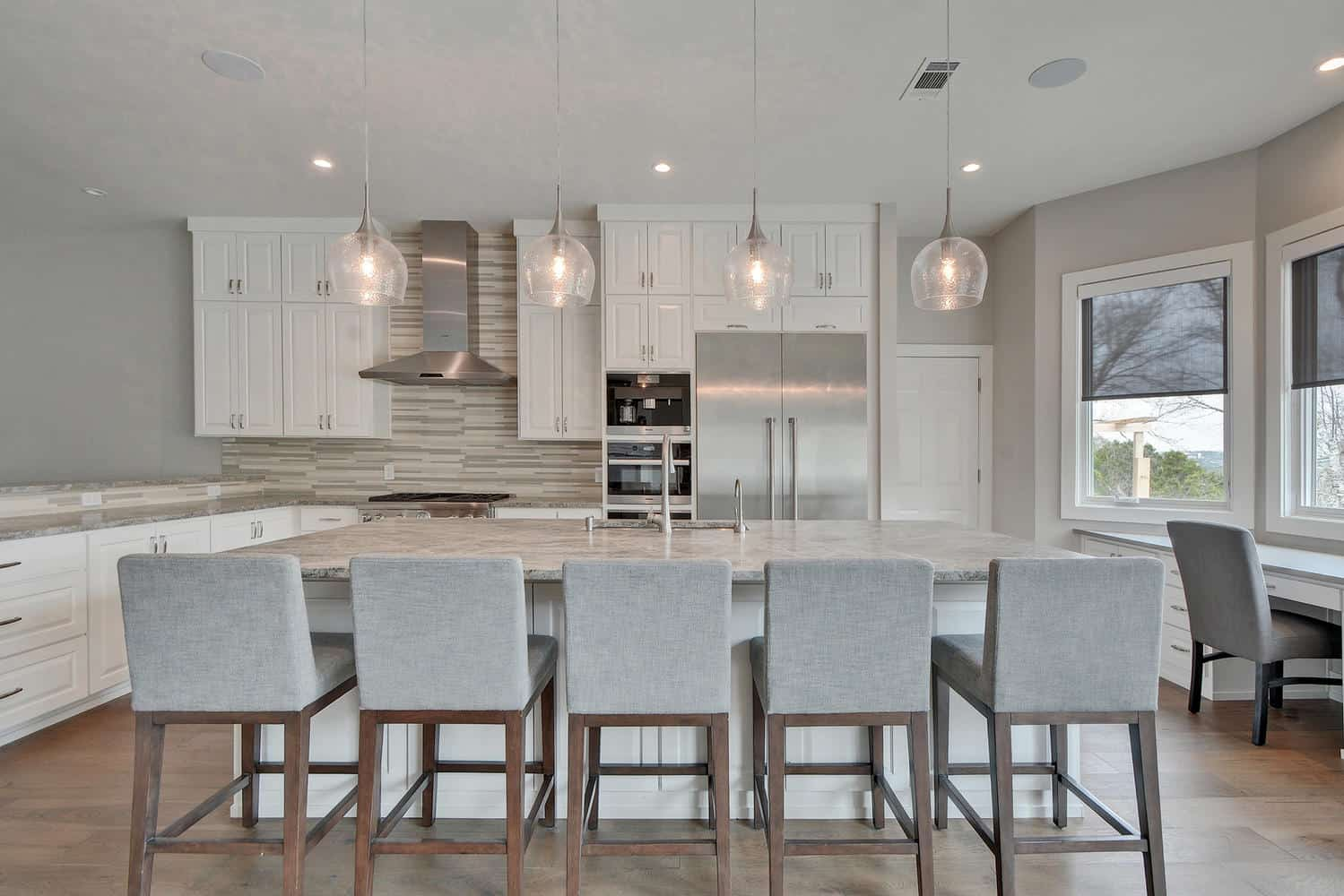 Etch Design Group - open concept kitchen in white and light colors with Thermador fridge.
