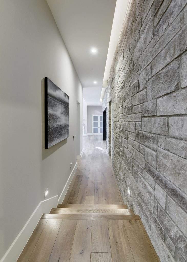 modern farmhouse interior design | hallway with stone wall | austin, texas