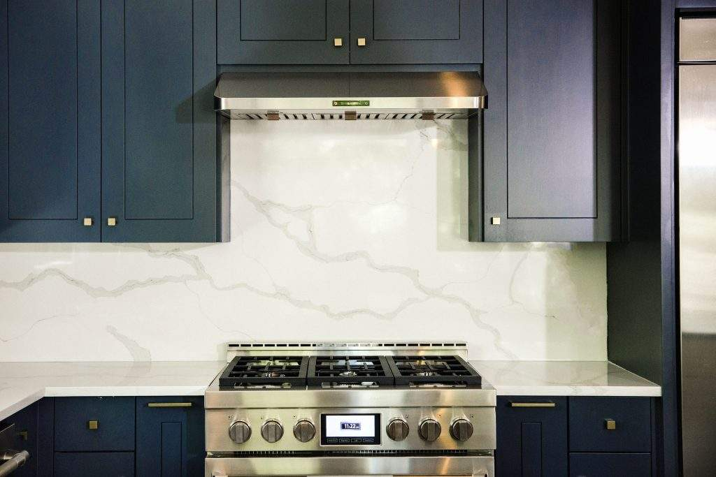 Etch Design Group | kitchen stove remodel with vent hood| austin, texas