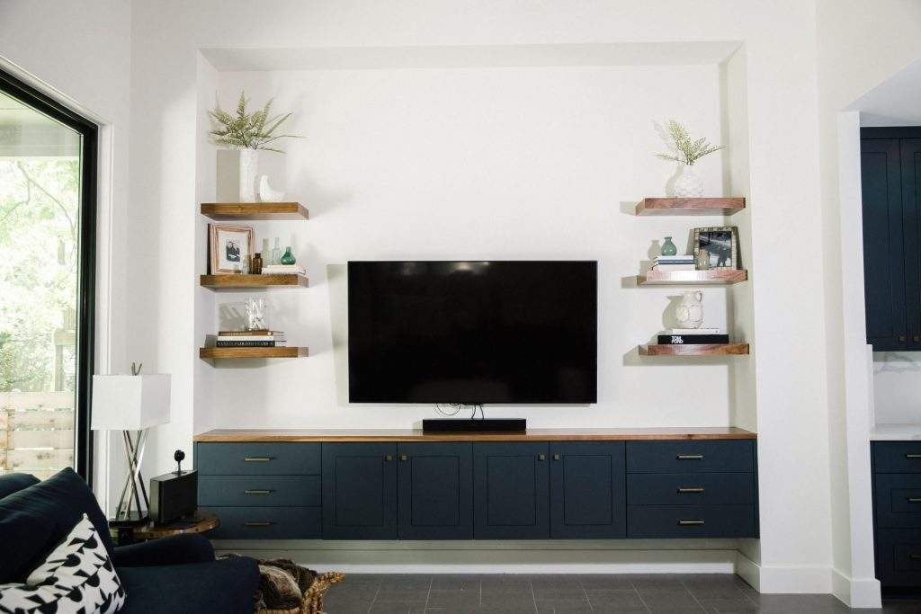 interior design remodel | entertainment center with floating wood shelves | austin, texas
