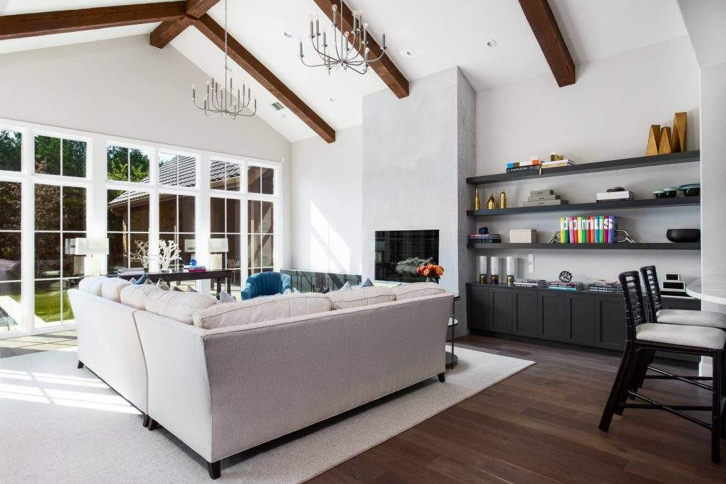 interior design austin | living room with lots of windows and high ceiling and fireplace | austin, texas