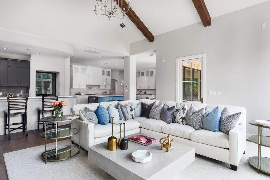 interior design remodel | barton Creek with ample natural light and a light color palate and blue accents open concept with kitchen and wet bar | ausitn, texas