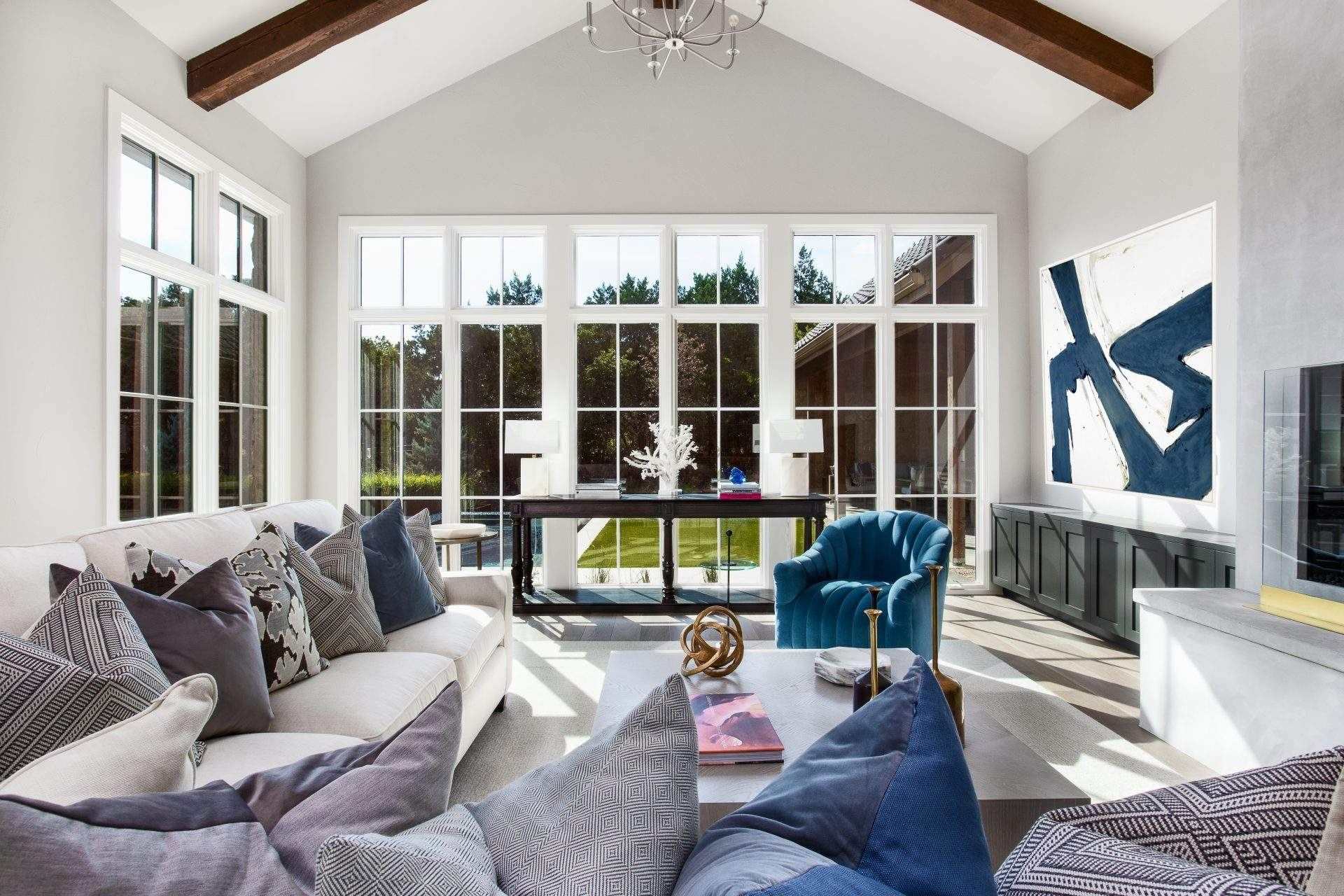 Etch Design Group - a remodel in Barton Creek with ample natural light and a light color palate and blue accents.