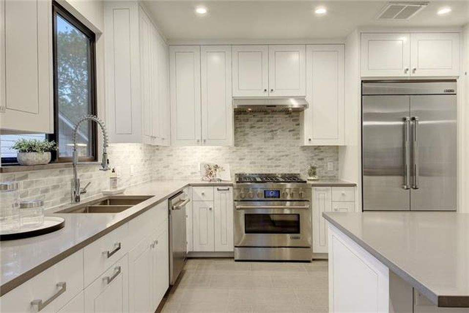 interior design remodel | stove, white cabinets, stone back splash | austin, texas