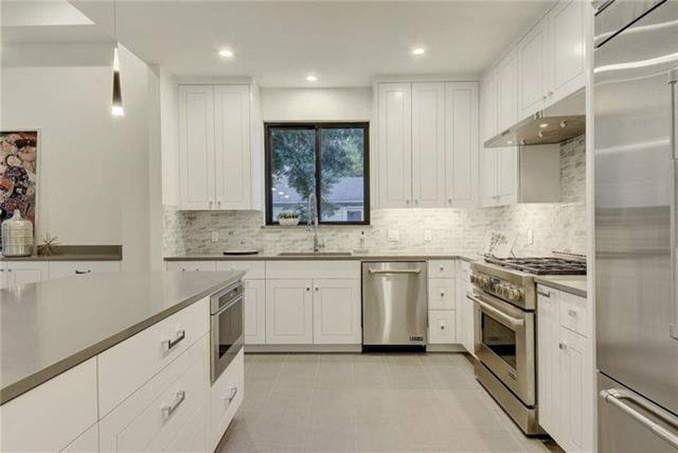 interior design remodel | white cabinets with stove and refrigerator, sink and dishwasher | austin, texas