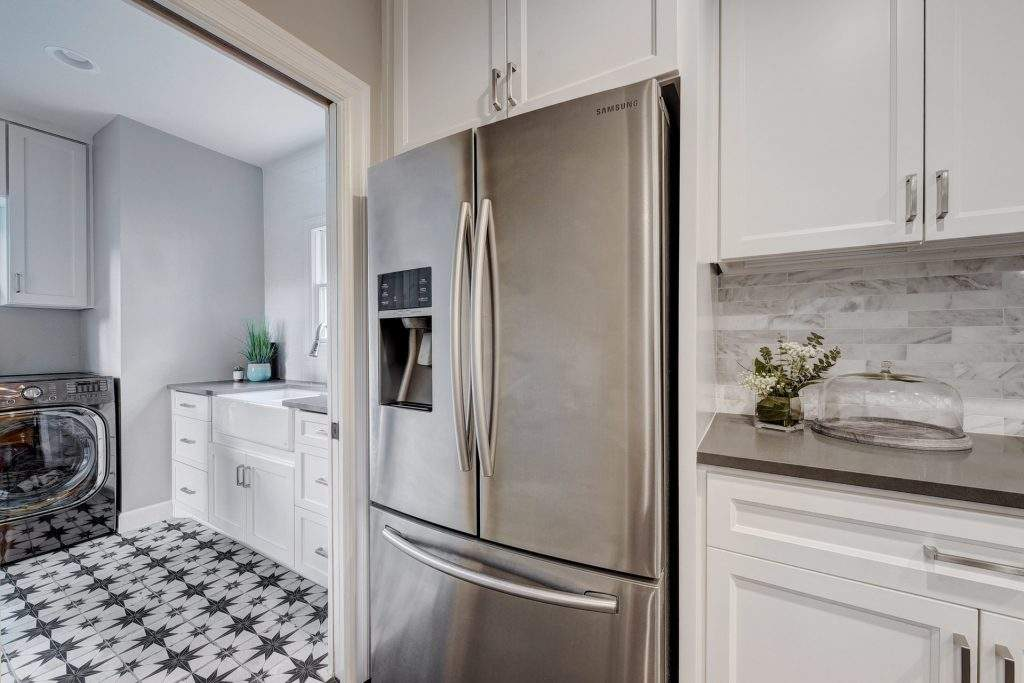 home interiors Austin | bryker woods laundry room off kitchen after| austin, texas