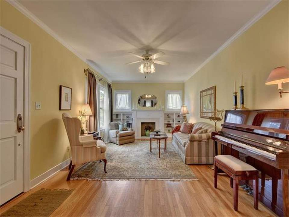 home interiors Austin | bryker woods living room with fireplace and piano before | austin, texas