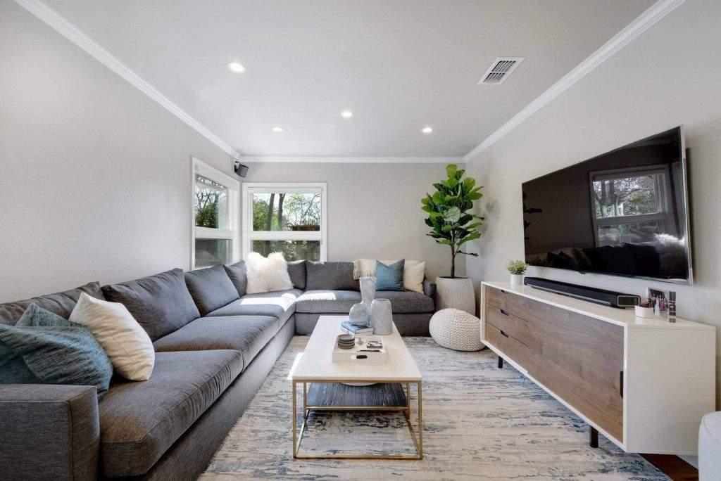 Allandale - interior design Austin | gray couch, side chair, blue accents 1 | austin, texas