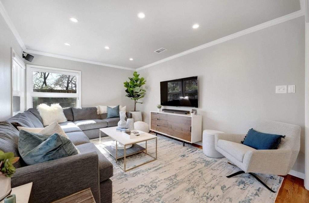 Allandale - interior design Austin | gray couch, side chair, blue accents | austin, texas