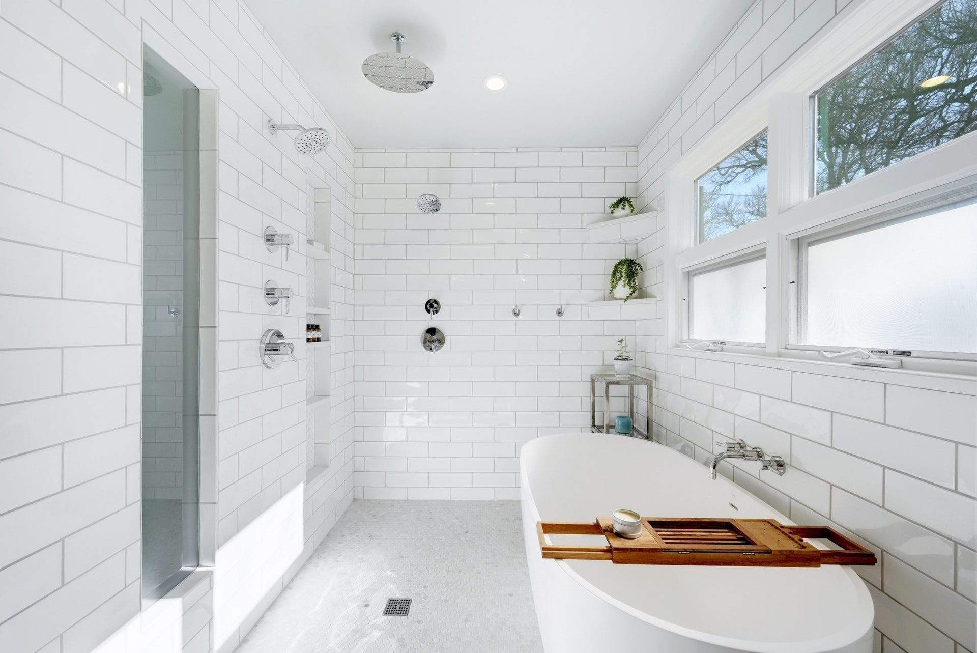 Allandale - interior design Austin | shower with shelves, tub, and windows | autstin, texas