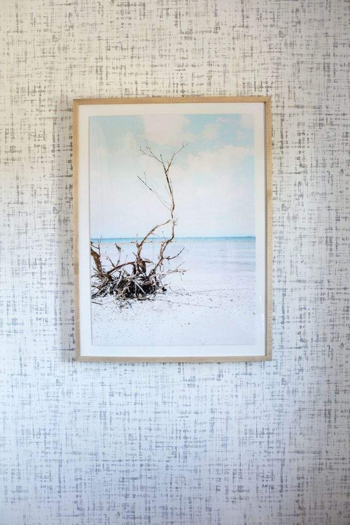 travis heights | gray and white wallpaper with beach art | austin, texas