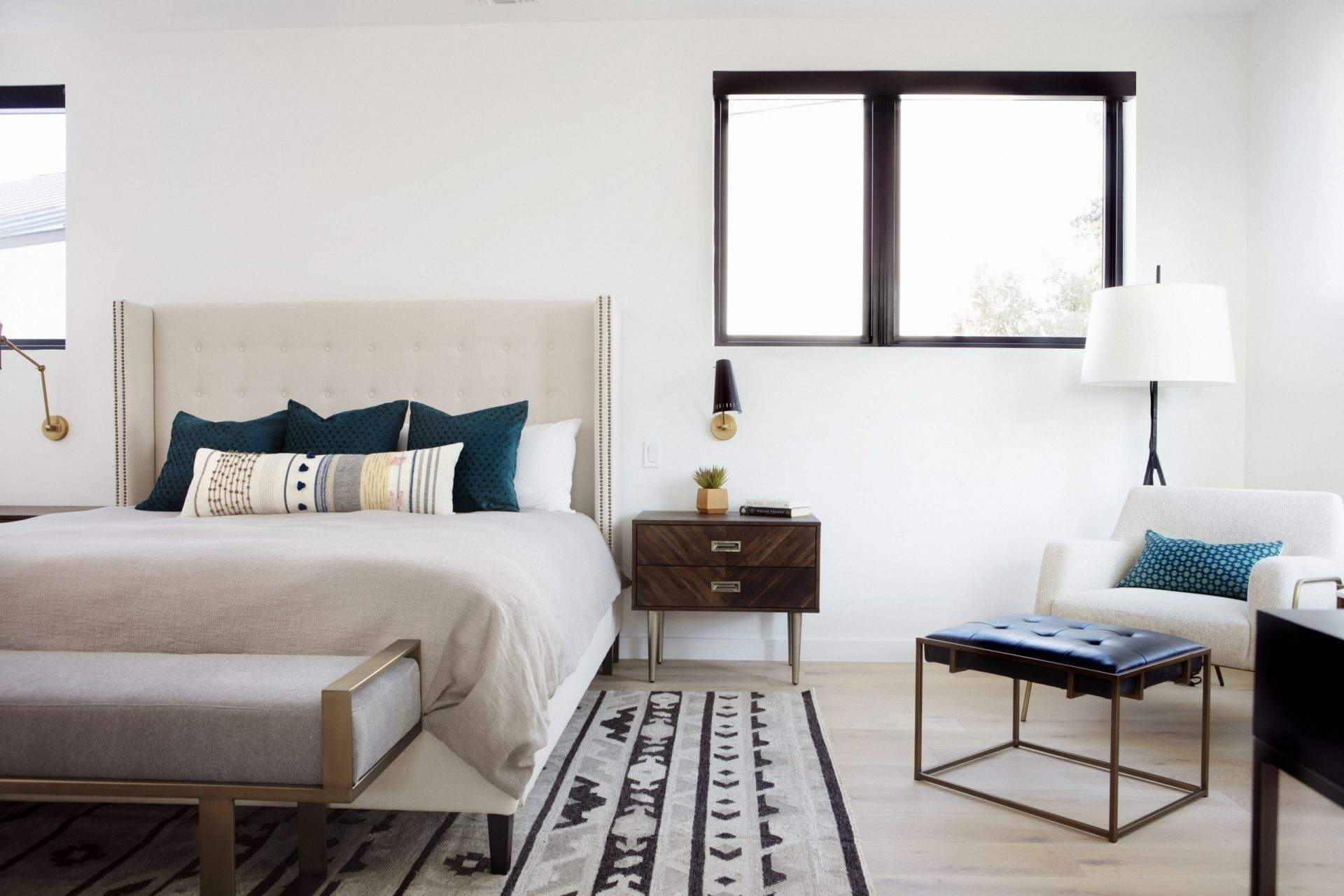 travis heights | bedroom with fabric bed, nightstand and stool at foot of the bed | austin, texas