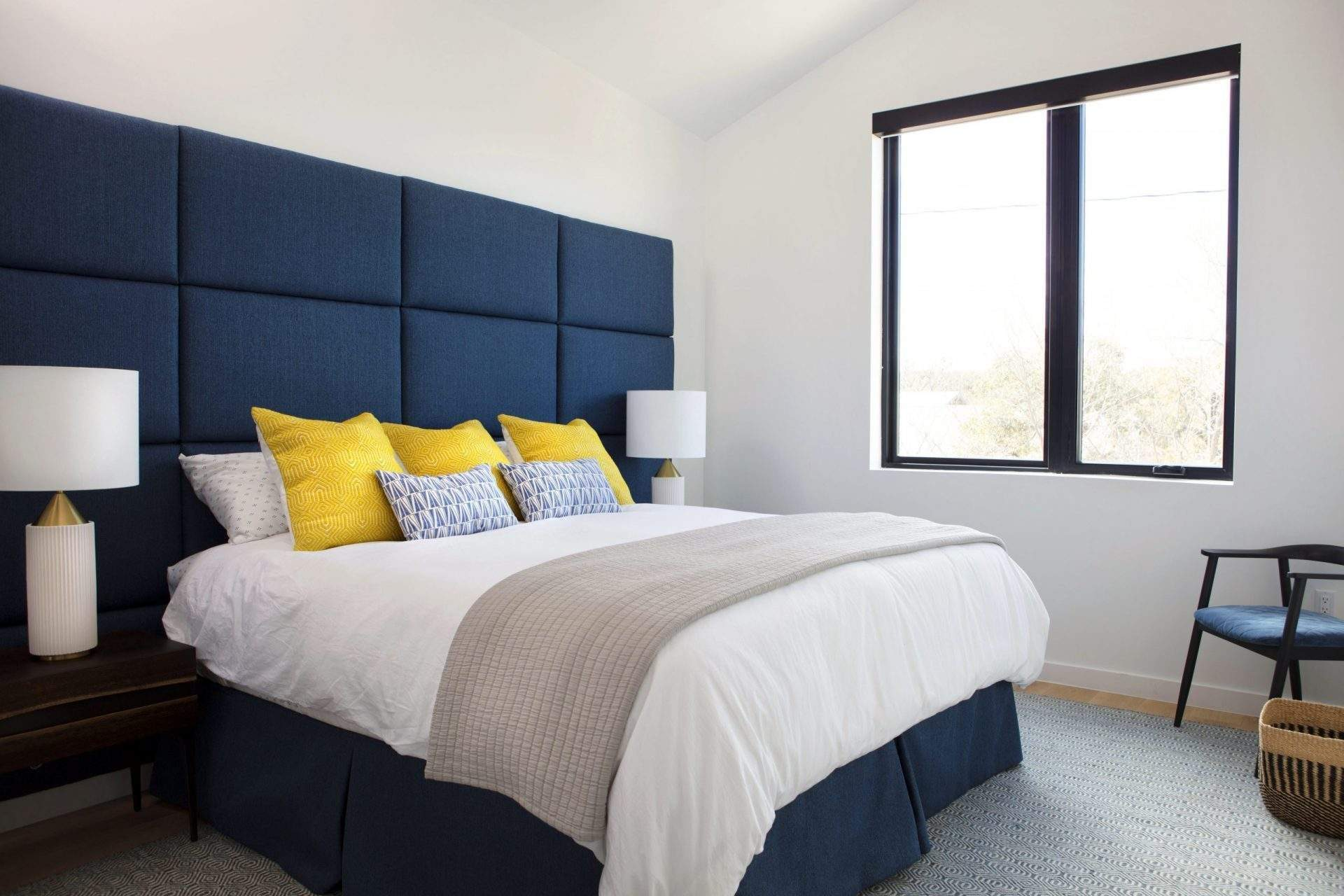 travis heights | blue headboard, nightstand, and lamp and window | austin, texas
