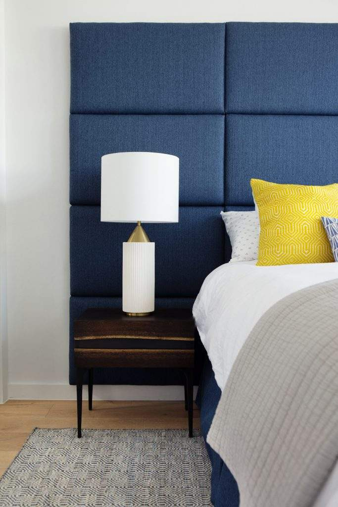 travis heights | blue headboard, nightstand, and lamp | austin, texas