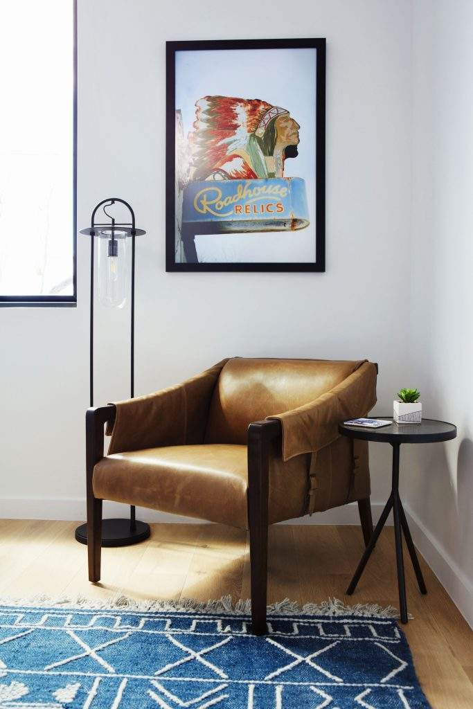 travis heights | leather side chair with native american art above | austin, texas