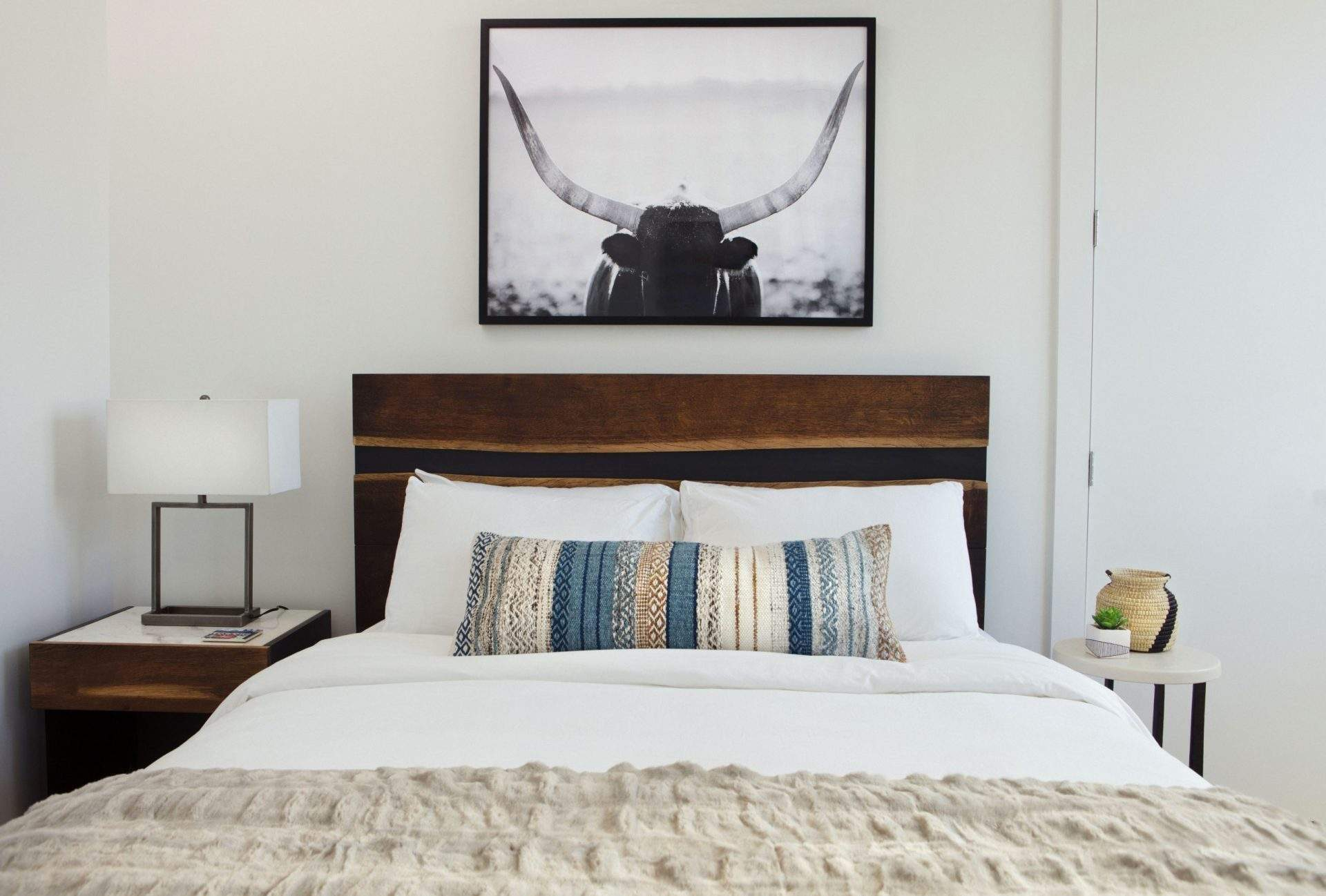 travis heights | bed with long horn art above | austin, texas
