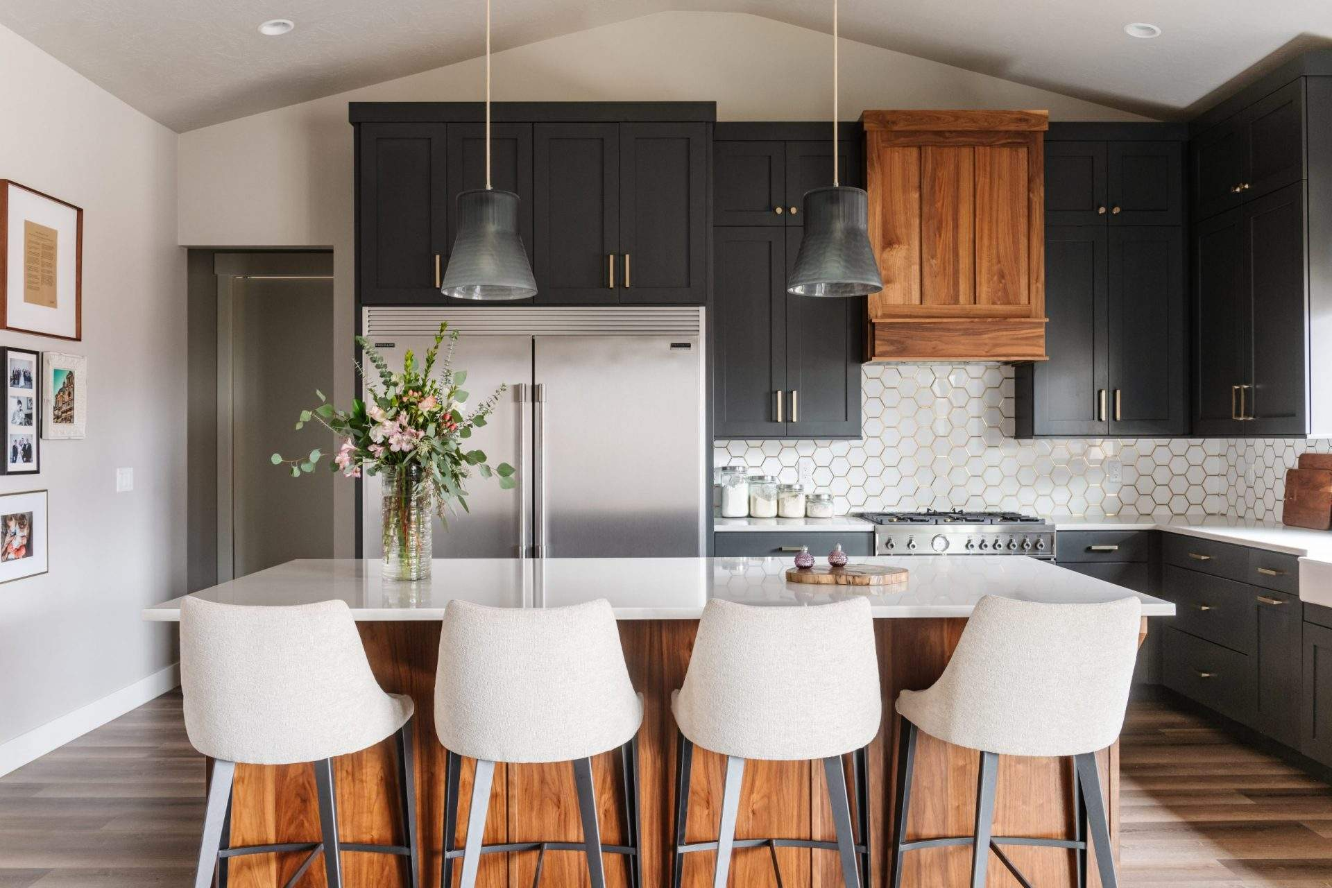 Kitchen with large island and 4 counter stools