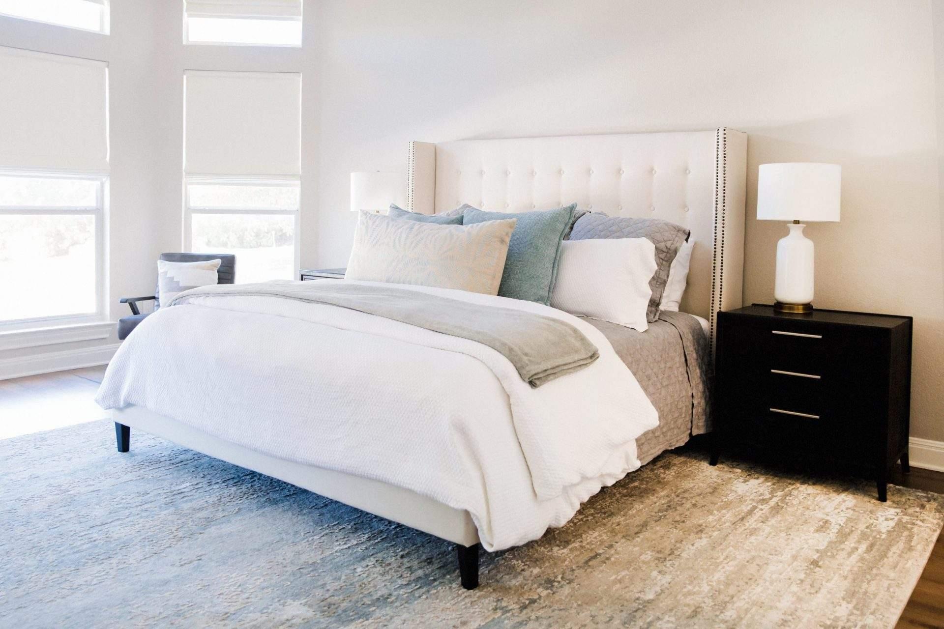 Northwest Balcones - interior design austin | cream bed with blue accent pillows | austin, texas
