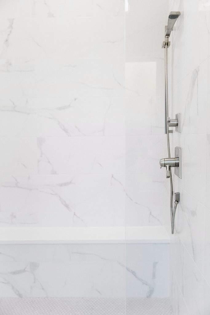 Northwest Balcones - interior design austin | shower with bench and fixture | austin, texas