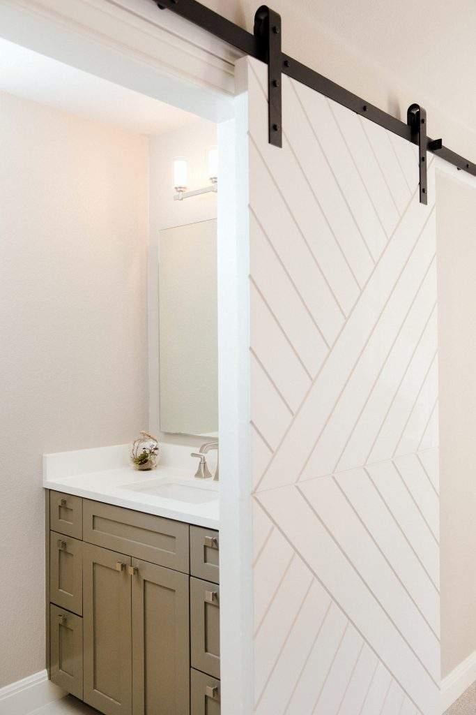 Northwest Balcones - interior design austin | farmhouse door with geometric design| austin, texas