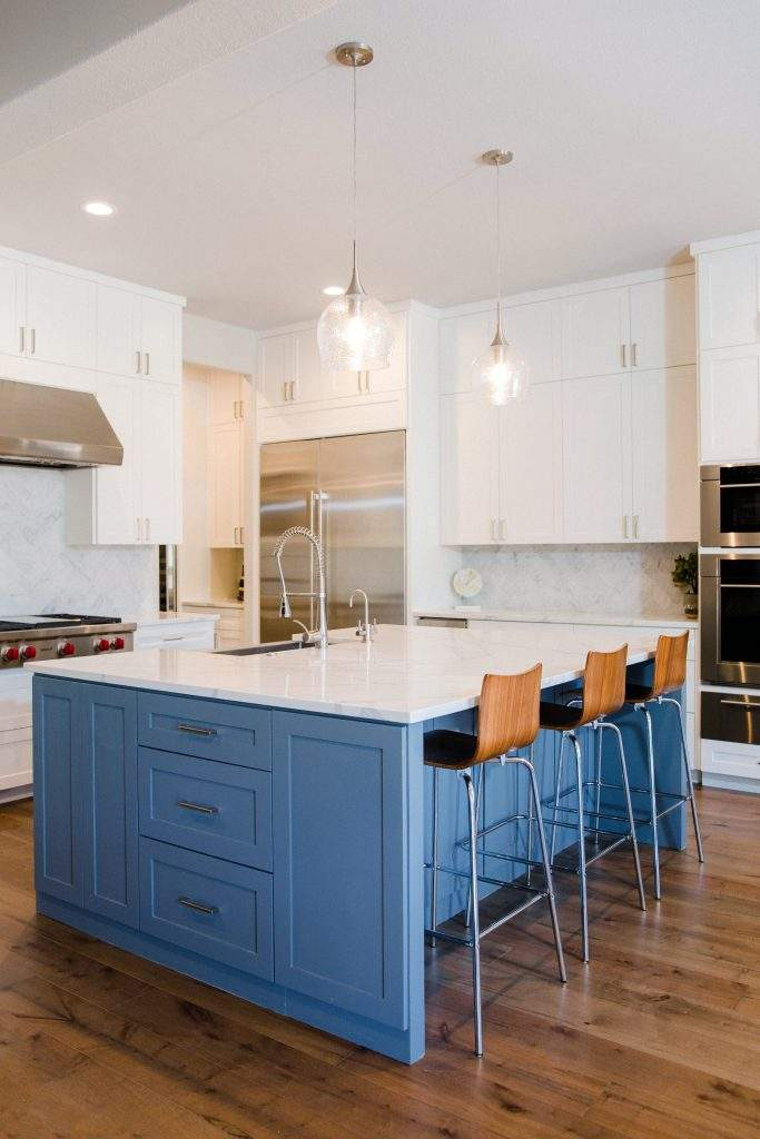 Northwest Balcones - interior design austin | kitchen with a white color palette and blue kitchen island - home in Northwest Balcones side view 1| austin, texas
