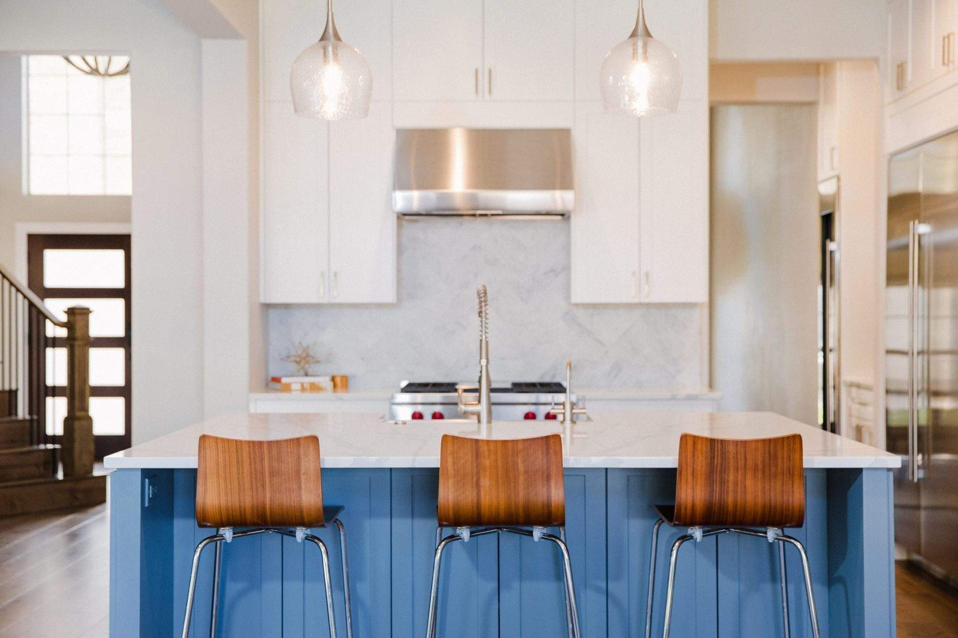 Northwest Balcones - interior design austin | kitchen with a white color palette and blue kitchen island - home in Northwest Balcones | austin, texas