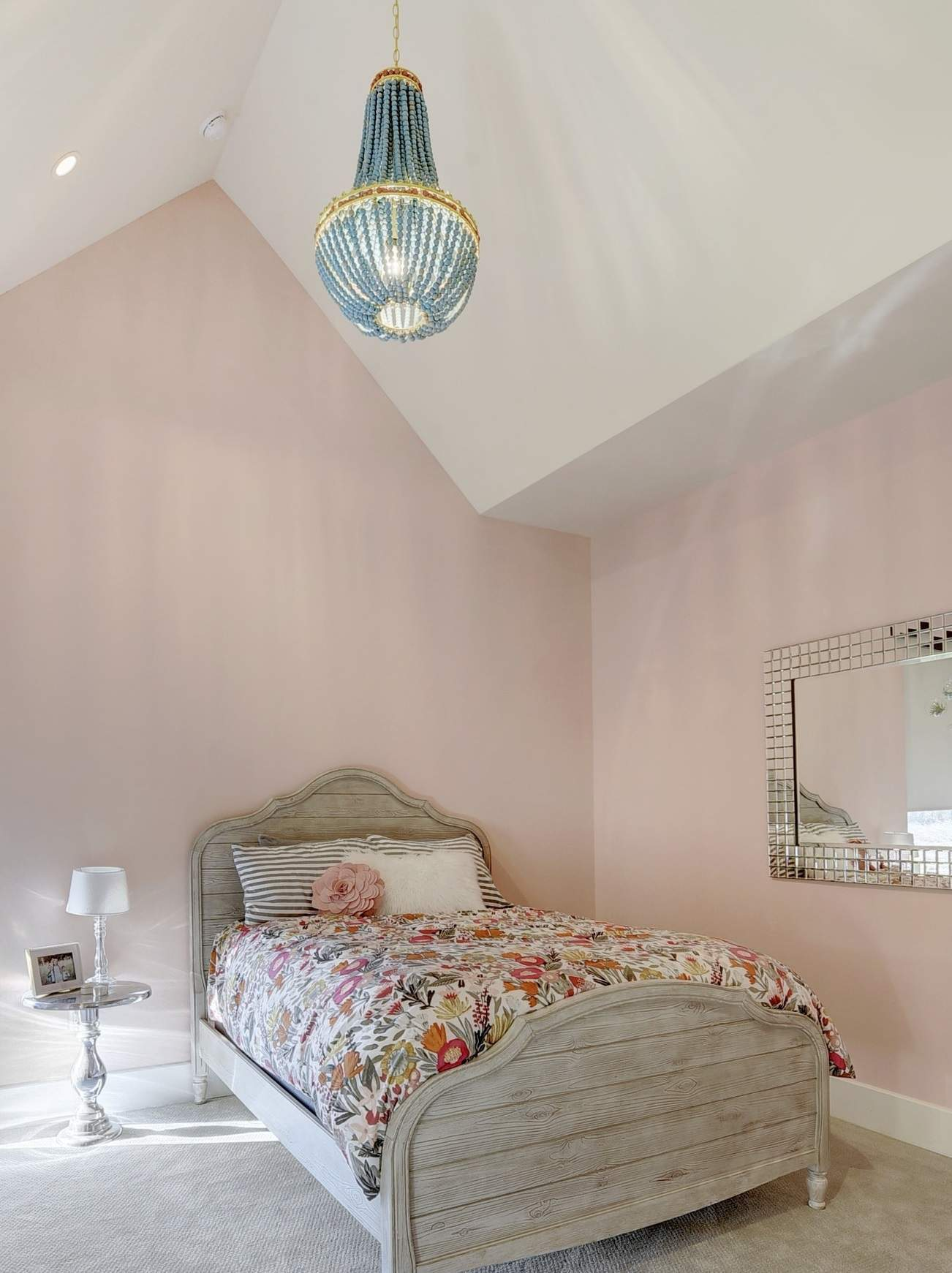 bedroom interior design | bedroom with vaulted ceiling and chandelier | austin, texas