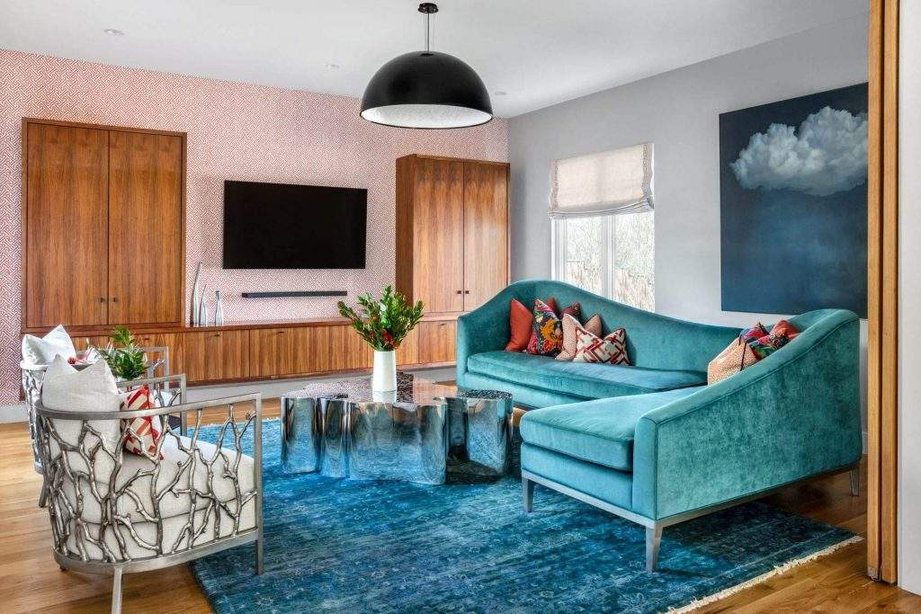 Colorful living room with blue sofa and 2 chairs