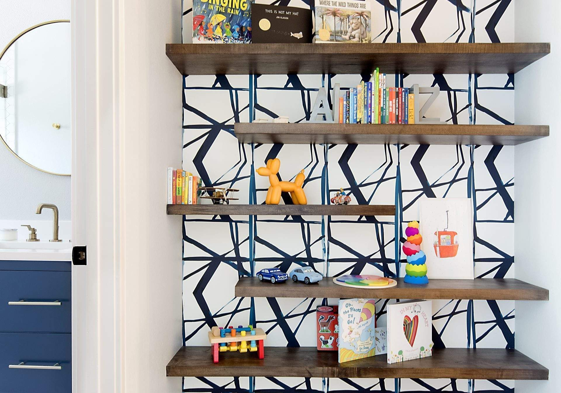 interior design remodel | floating shelves in hall with wallpaper behind | austin, texas