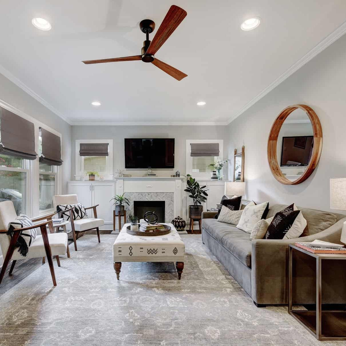 Etch Design Group - light colored living room with a hint of character.